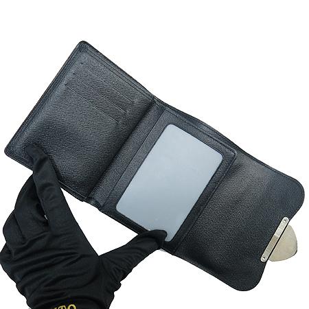 Louis Vuitton(루이비통) M66582 은장 로고 장식 블랙 에삐 레더  조이월릿 중지갑