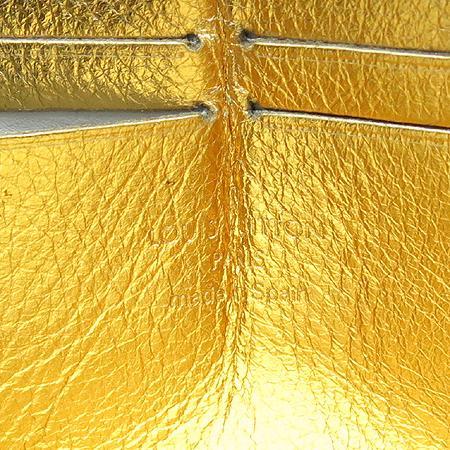 Louis Vuitton(루이비통) M95569 수할리 골드 브론즈 지피 월릿
