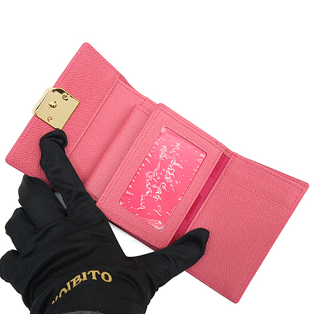 LOVCAT(러브캣) 베이지 래더 금장 로고 장식 반지갑