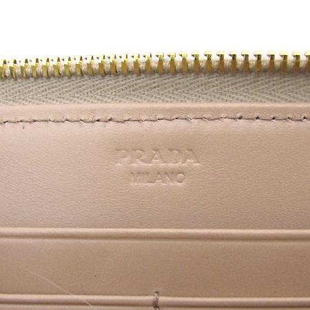 Prada(프라다) 1M0506 화이트 램스킨 금장로고 짚업 장지갑