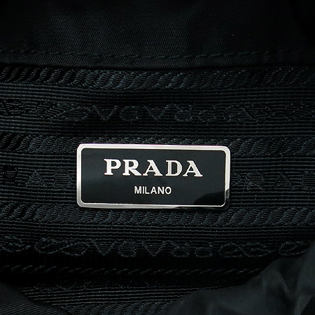 Prada(프라다) VA0914 삼각 로고 장식 패브릭 복주머니 미니 크로스백